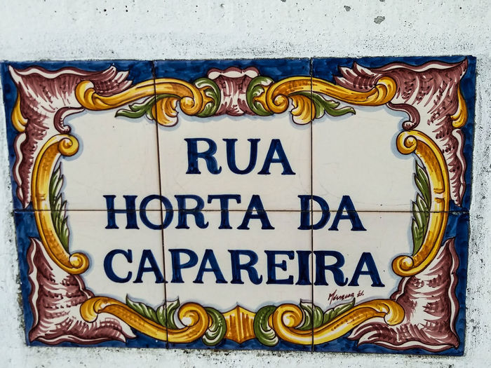 """Portugal EyeEm ZOOM in to see details... Constância, almost all street names in this town are hand painted on """"azulejos"""": https://en.wikipedia.org/wiki/Azulejo. Here are some examples of this beautiful Art... Text Communication Western Script No People Sign Architecture Close-up Pattern Multi Colored Day Outdoors Yellow Craft Creativity Entrance Ornate Information Information Sign Representation Art And Craft"""