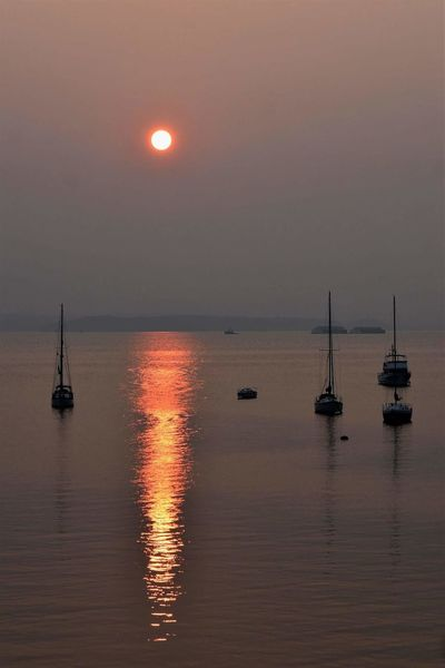 Reflection Sunset Sea Nautical Vessel Water Night Horizon Over Water Tranquility Moon No People Buoy Sky Harbor Beach Scenics Silhouette Outdoors Tranquil Scene Travel Destinations Landscape