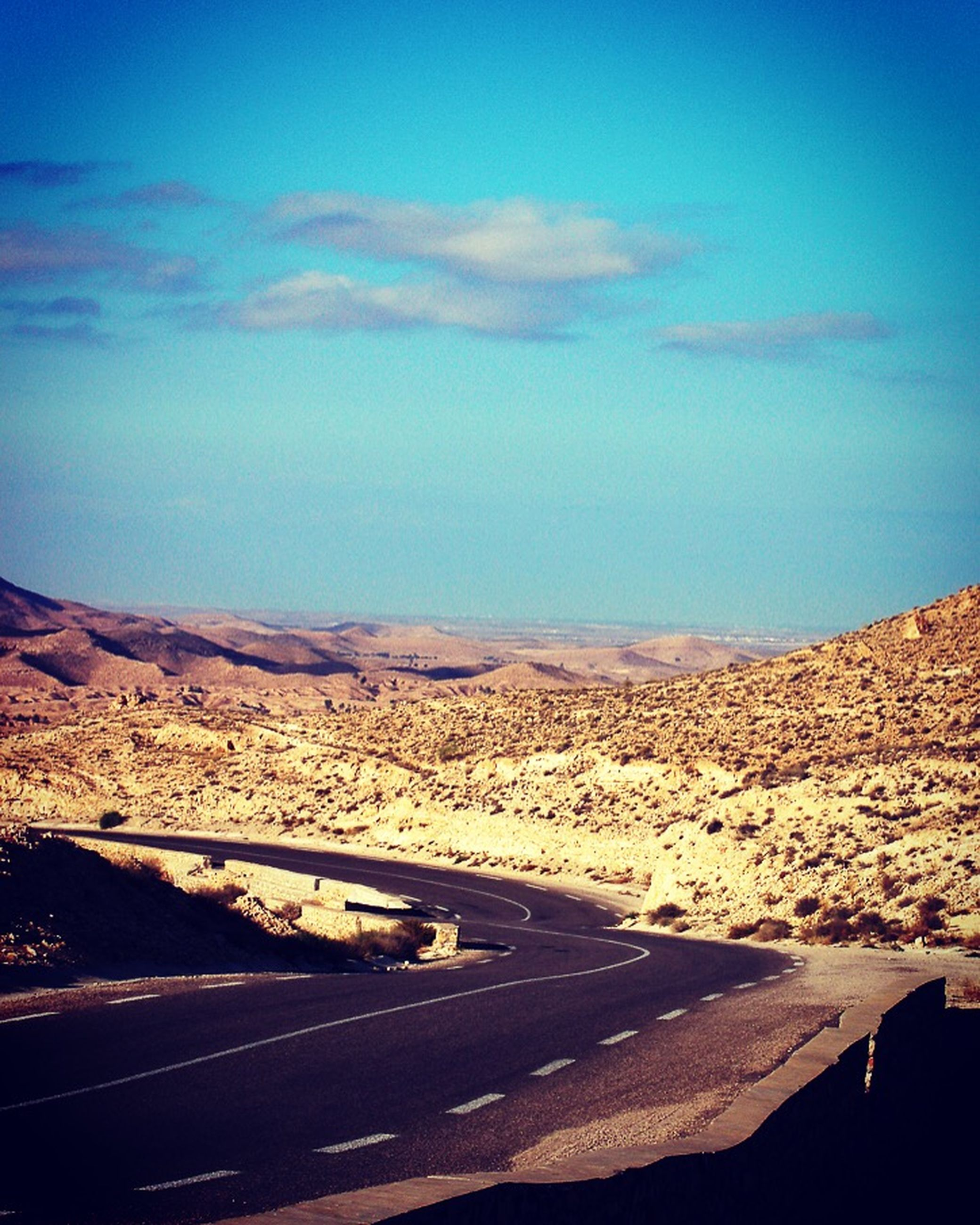 landscape, road, blue, sky, tranquil scene, desert, tranquility, mountain, transportation, scenics, the way forward, nature, beauty in nature, horizon over land, remote, road marking, non-urban scene, arid climate, cloud, country road