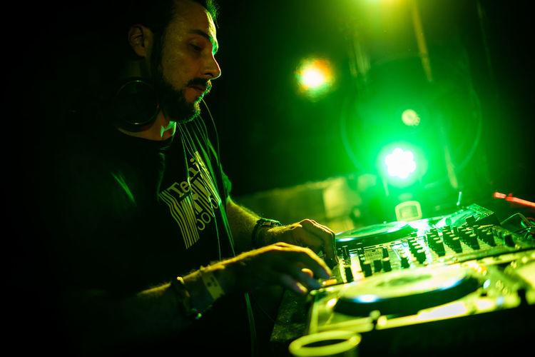 Man playing with illuminated lights at night