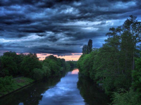 Sky Water Storm Cloud River Dusk Dramatic Sky Riverside Clouds Outdoors Tranquil Scene Neighborhood