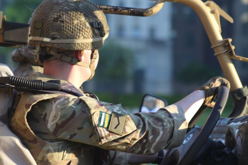 Side View Of Army Soldier Sitting In Vehicle