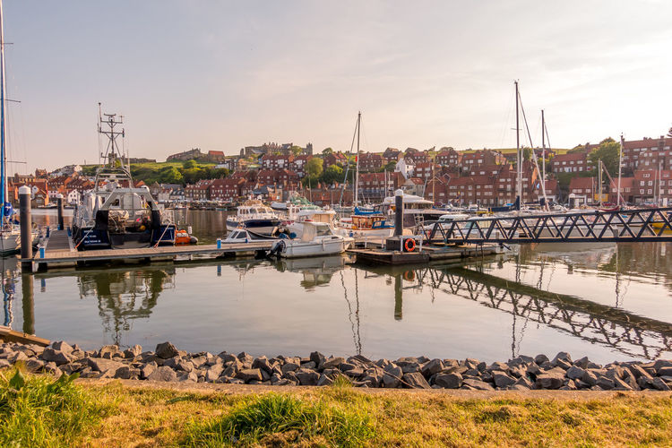 Whitby Whitby Harbour Whitby View Whitby North Yorkshire North Yorkshire Yorkshire Tourist Destination Sunny Day Blue Sky Seaside Seaside Town Reflection Nautical Vessel Yacht Marina No People Sailboat Port Harbor Sky Moored Water Transportation River Mast