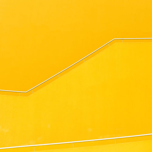 Yellow Railing Against Wall