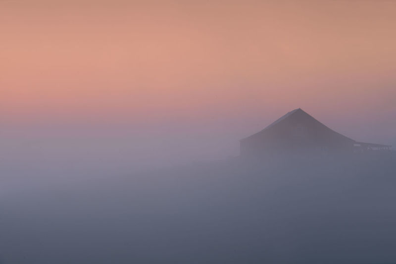 Sky Architecture Sunset Fog Scenics - Nature Beauty In Nature Tranquil Scene No People Nature Tranquility Built Structure History Building Exterior Idyllic Tourism The Past Orange Color Copy Space Outdoors Travel Ancient Civilization Mountain Peak