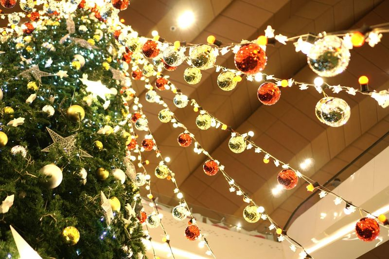 Low angle view of illuminated christmas lights hanging on ceiling