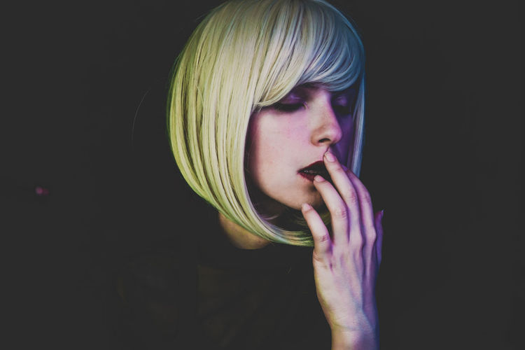 Studio Shot Black Background One Person Indoors  Portrait Headshot Holding Young Adult Human Body Part Body Part Human Face Close-up Hair Blond Hair Front View Cut Out Copy Space Food And Drink Hairstyle Art Artistic Mood Sad Depression - Sadness Night
