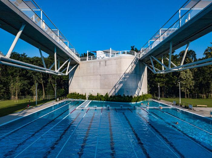 View of swimming pool against clear blue sky