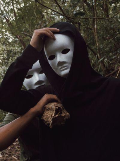 Men Wearing Spooky Mask