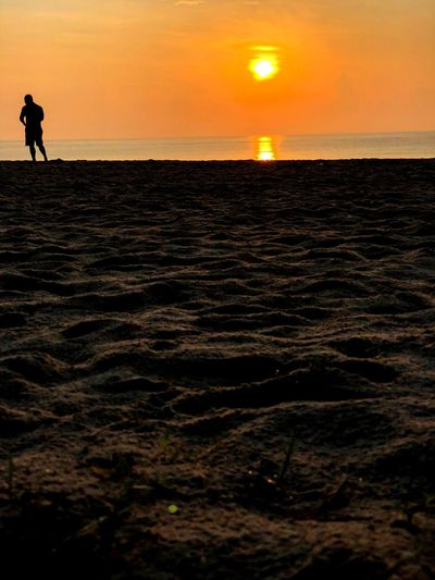 Tranquility... Sunset Sky Sea Silhouette Water Scenics - Nature Beach Beauty In Nature Nature Horizon Over Water Tranquility Sun Tranquil Scene Outdoors Horizon Land Real People