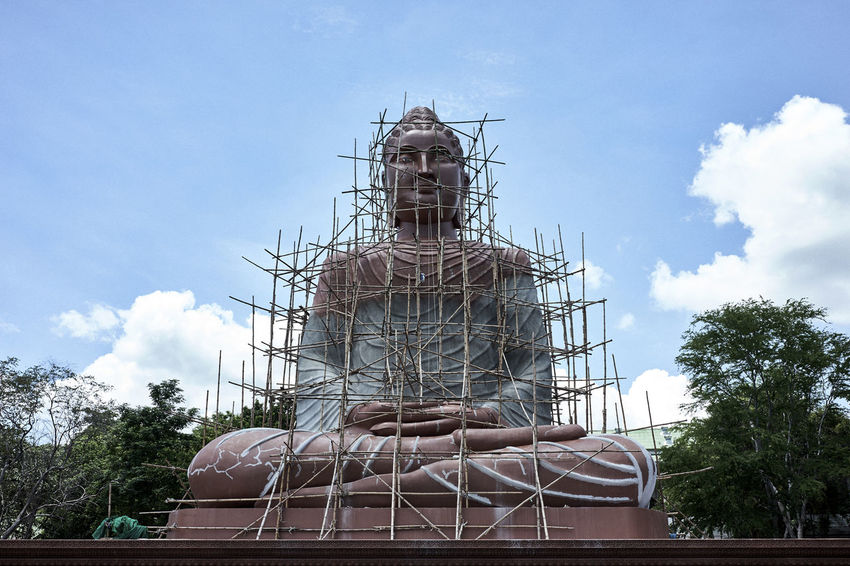 Giant Buddha statue under construction in Thailand Architectural Feature Buddha Buddha Statue Buddism Cloud History Kanchanburi Low Angle View Monument Renovation Renovations Sky Thailand Under Construction