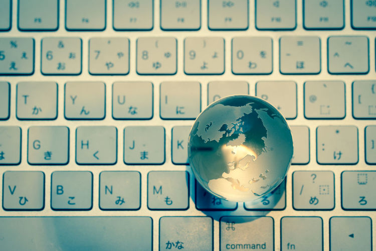 Directly above shot of crystal ball on computer keyboard