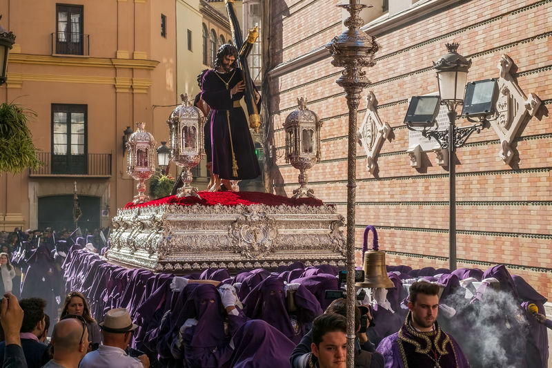 People in the procession in the Holy Week (Semana Santa) in a Spanish city. Malaga, Spain - March 26, 2018. Catolic Church Children Easter Easter Ready Historical Building Holy Week Malaga People Watching SPAIN Semana Santa Spanish Uniform Uniforms Adult Architecture Building Building Exterior Built Structure Catolicism Celebration City Crowd España Event Festival Group Of People Large Group Of People Leisure Activity Lifestyles Men Musical Instrument Musician Musician Bands Old Buildings Old City Procession Real People Religion Spain Is Different Spanish Arquitecture Spanish Culture Street Women EyeEmNewHere Adventures In The City The Street Photographer - 2018 EyeEm Awards