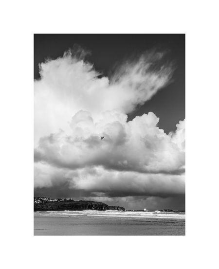 Digital composite image of clouds over sea