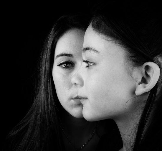 Deux sœurs. Portrait Photography Portrait Of A Woman Double Sister Only Women One Woman Only Headshot Adult Portrait Young Adult One Young Woman Only Human Face Studio Shot Beautiful Woman Black Background Young Women Real People