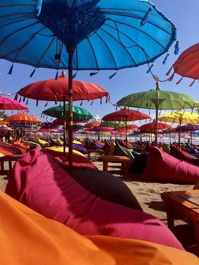 Umbrellas on beach against sky