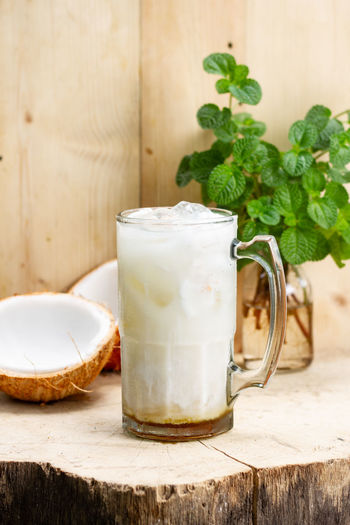 coconut ice Food And Drink Food Freshness Drink Refreshment Table Leaf Herb Indoors  Healthy Eating Wood - Material Plant Part No People Glass Still Life Close-up Wellbeing Household Equipment Mint Leaf - Culinary Drinking Glass Breakfast Non-alcoholic Beverage
