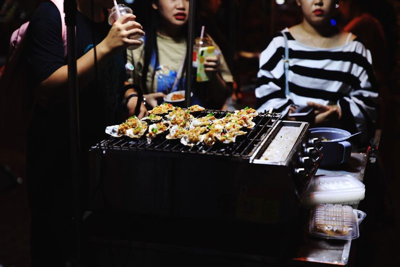 Group of people on barbecue grill