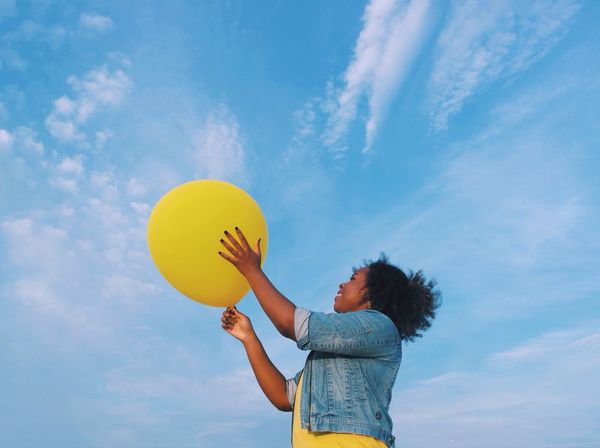 Paint The Town Yellow Sky Balloon One Person Smile Cloud - Sky Holding Low Angle View Leisure Activity Real People Enjoyment Outdoors Elementary Age Happiness Playing Day Lifestyles Girl Perspective Nature People EyeEm Ready