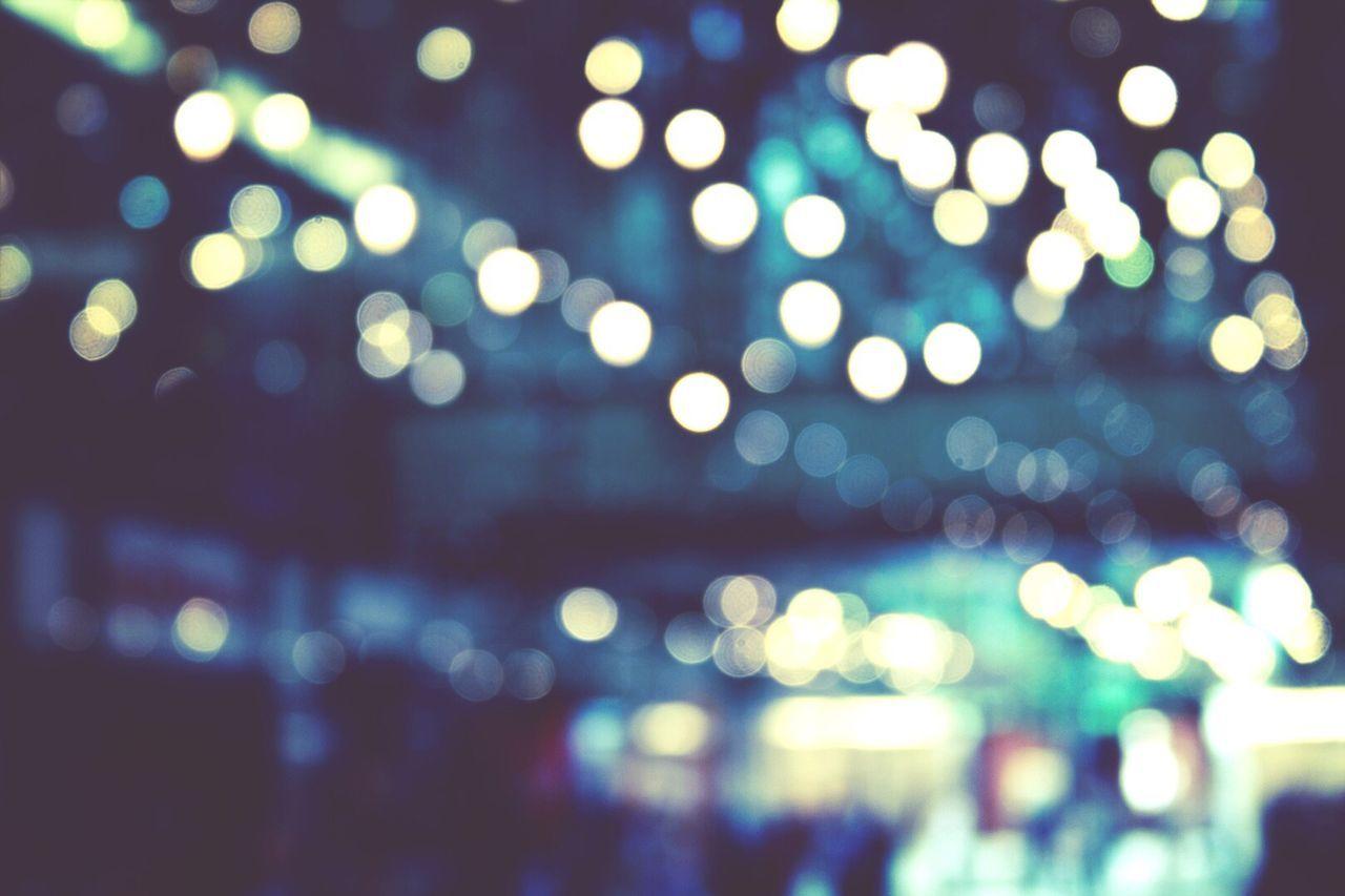 Defocused image of christmas lights in city
