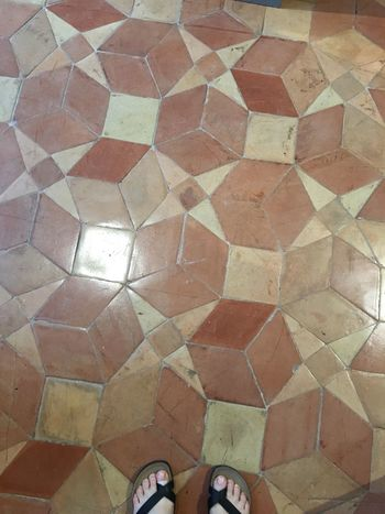 Flooring Pattern Indoors  Personal Perspective Standing Low Section Human Leg Tiled Floor Multi Colored Medieval Architecture Ancient Floor Decoration