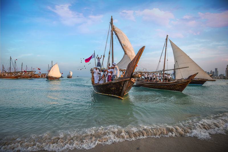 Traditional Bearings Festival, Doha, Qatar for fishing and pearl Katara Cultural Village Qatar Doha,Qatar Cultures Culture Hertitage Travel Tourism Arab Gulf Water Nautical Vessel Transportation Mode Of Transportation Cloud - Sky Beach Beauty In Nature Motion Sailboat