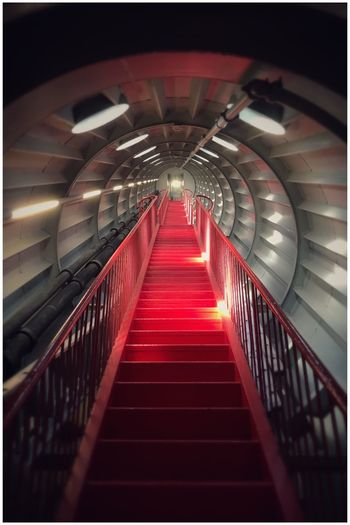 Check out the retro-futuristic vibe. Architecture Brussels Kris Demey Photography Railing Staircase Transfer Print The Way Forward Indoors  Steps And Staircases Red Illuminated Diminishing Perspective Built Structure No People Lighting Equipment Night Light At The End Of The Tunnel Direction Transportation Auto Post Production Filter Tunnel