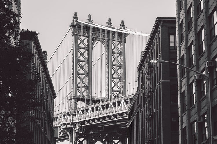 Low angle view of manhattan bridge against sky