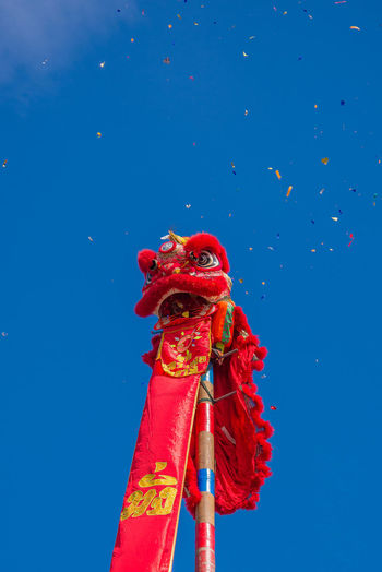 Low angle view of chinese dragon against clear blue sky