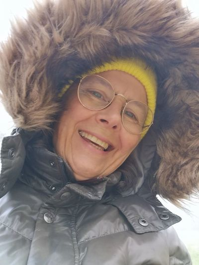 Portrait of smiling woman with snow