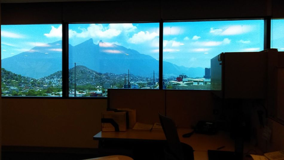 Cerro de la Silla Beauty In Nature Belleza De La Naturaleza Cerro De La Silla Day Desk Home Interior Indoors  Looking Through Window Maravilla Mountain Mountain Range Nature No People Office Building Oficina Paisaje Natural Scenics Sky Ventana Window The Week On EyeEm Mix Yourself A Good Time Shades Of Winter Indoors  Tree Close-up