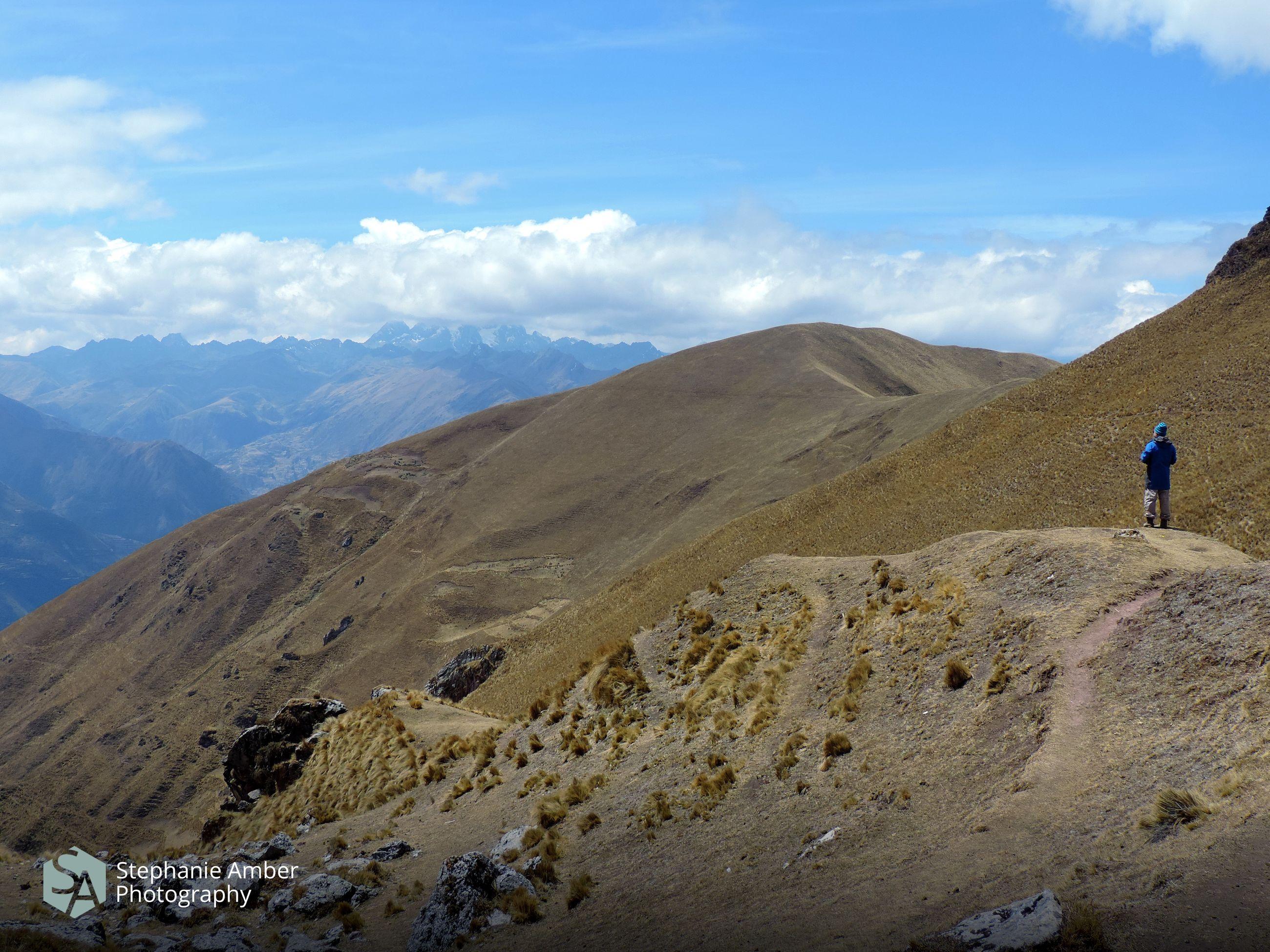mountain, leisure activity, scenics - nature, sky, beauty in nature, real people, mountain range, tranquil scene, lifestyles, hiking, non-urban scene, tranquility, cloud - sky, activity, nature, adventure, day, landscape, environment, idyllic, outdoors, mountain peak