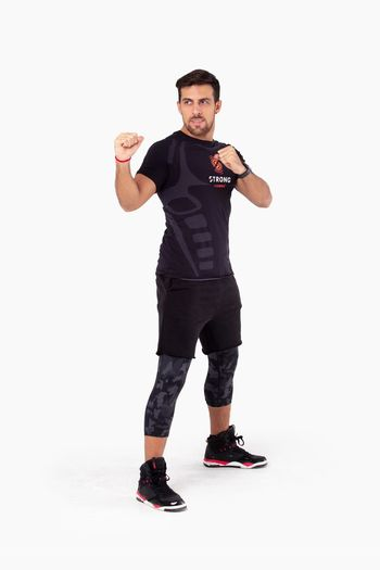 Strong Zumba Zumba Fitness Fitness HIIT Workout Gym Athletic Studio Shot White Background Full Length One Person Standing Gesturing Clothing Males  Lifestyles Cut Out Kick Boxing Sportive Sport Martial Arts