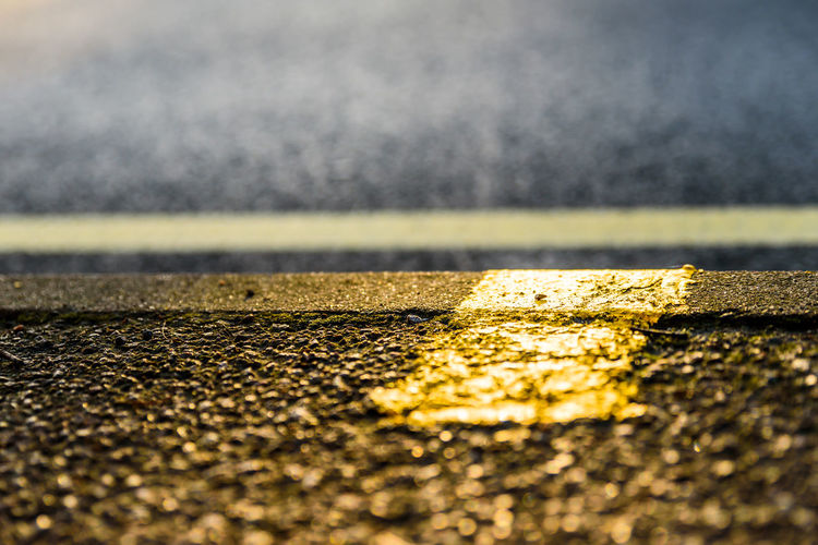 Closeup view yellow road marking line Paint The Town Yellow Asphalt Day LINE Marks No People Outdoors Road Road Marking Street Textured  Transportation Yellow