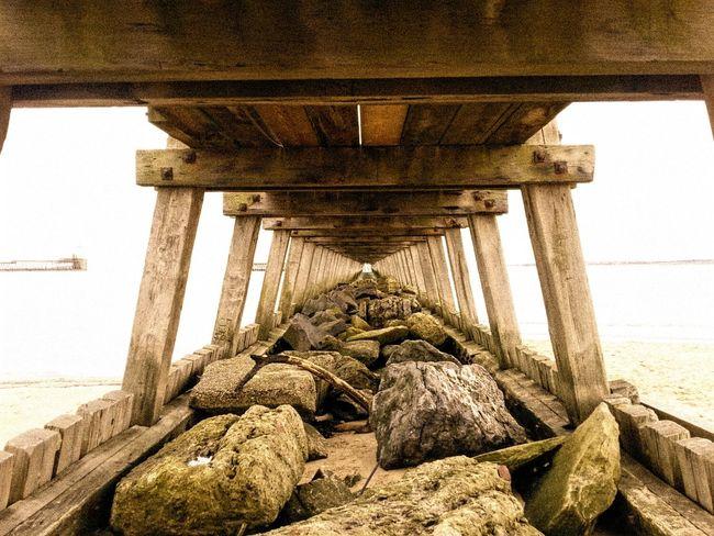 Under The Pier Seashore Rocks Structures & Lines Man-made Structure Coastline