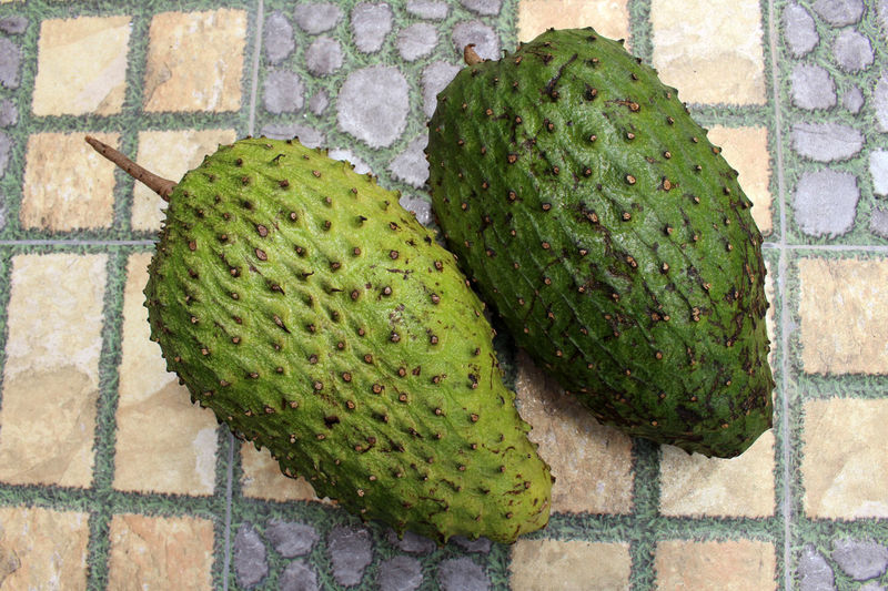 High angle view of fruit on floor against wall