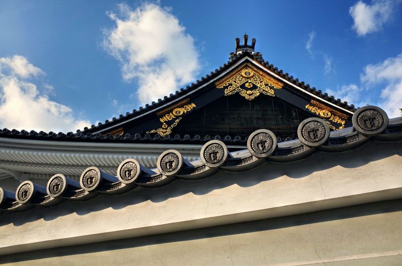 So beautiful of the rooftop details Kyoto Temple Blue Sky Roof Rooftop EyeEm Selects Built Structure Cloud - Sky Architecture Sky Building Exterior Low Angle View No People Day Religion Nature Belief Building Spirituality Art And Craft Place Of Worship Ornate Outdoors Eaves Pattern History The Past Sunlight Art And Craft Floral Pattern