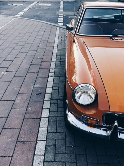 Close-up of classic car on street