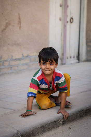 Casual Clothing Childhood Cute Day Focus On Foreground Front View Full Length Innocence Person Sitting