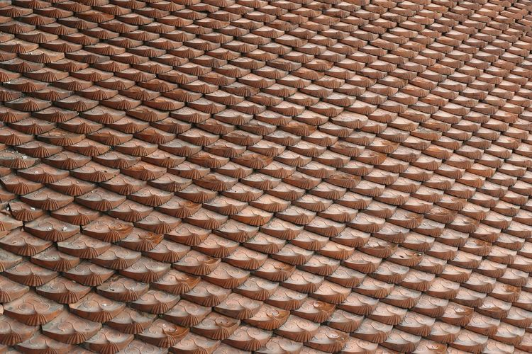 Tile roof pattern of a Buddhist temple in Hanoi Vietnam South East Asia Pattern Backgrounds Textured  Roof Tile Roof Structure Repeating Patterns Same  Material Tiles Lines Texture Surface Asian Temple Roof Top Details