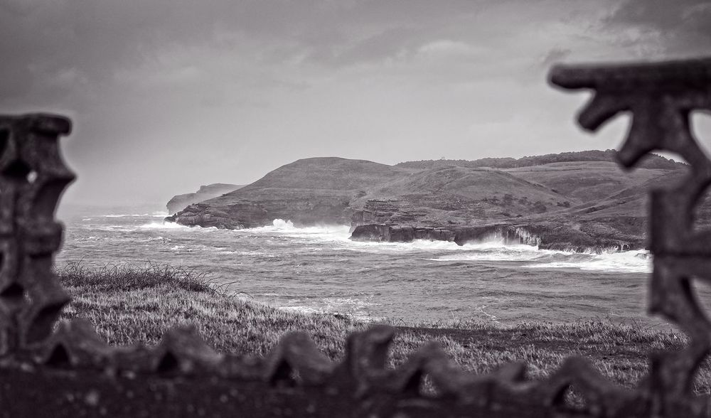 View of the Cantabrian coast from a hole in a fence Black & White Surf Ajo Beach Beauty In Nature Cloud - Sky Coast Day Frame Idyllic Land Nature No People Non-urban Scene Ocean Ojerada Outdoors Scenics - Nature Sea Sky Tranquil Scene Tranquility Water Wave Window