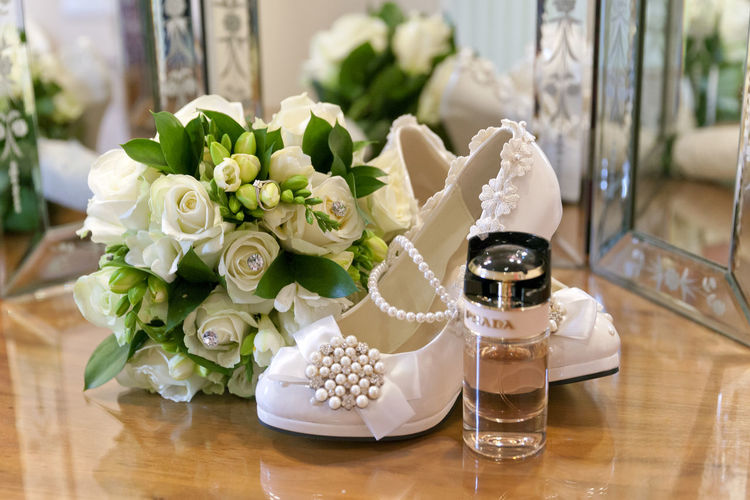 Bouquet Day Diamonds Flower Flower Arrangement Indoors  Love No People Pearls Perfume Roses Shoe Shoes Table Wedding Wedding Day Wedding Interior Wedding Photographer Wedding Photography Wedding Photos Wedding Venue Weddings