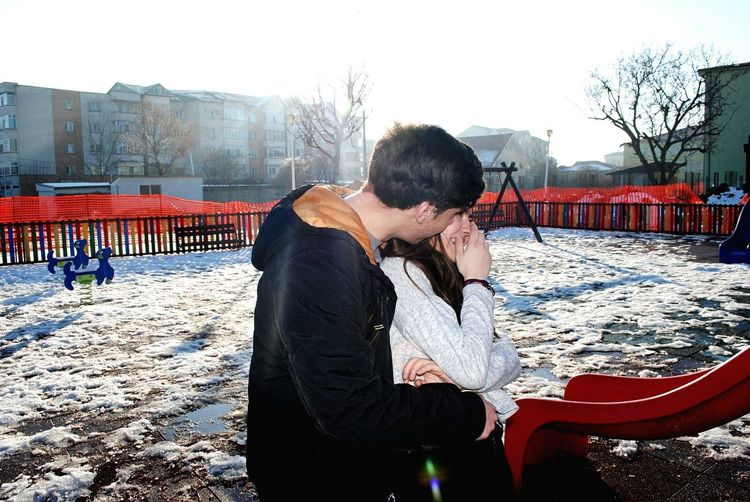 Young couple in playground in winter
