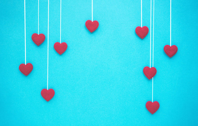 Heart shape made on blue colored background