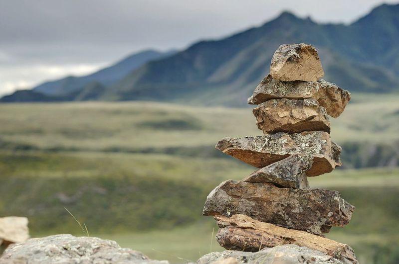 Stack Of Stones Against Blurred Landscape