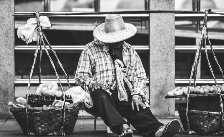 Sell eggs,toast Bangkok Thailand. Man Sell Egg Outdoors Be Tired Sit Down Sit Down And Relax Toasts Livelihood The Poor Part Of City Shelter