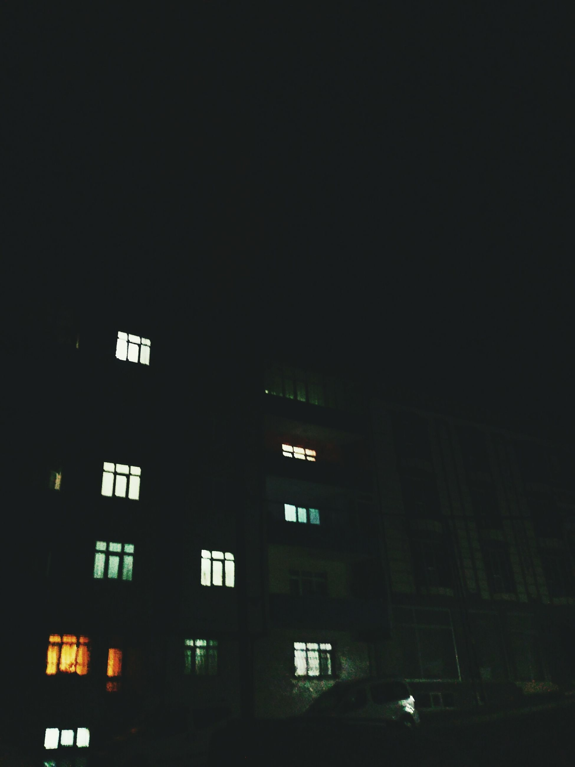 architecture, building exterior, built structure, window, dark, night, low angle view, city, building, illuminated, building story, outdoors, no people, city life