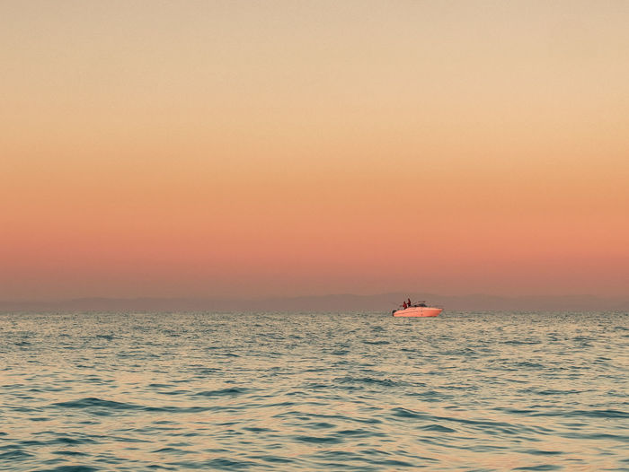 Water Sea Sky Nautical Vessel Sunset Beauty In Nature Transportation Scenics - Nature No People Tranquil Scene Mode Of Transportation Horizon Over Water Orange Color Tranquility Sailing Horizon Copy Space Nature Idyllic Outdoors Sailboat