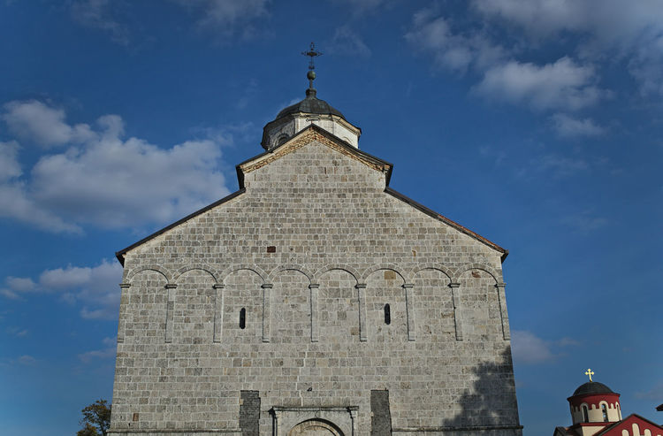 Main stone church in monastery Kovilj, Serbia Faith Hope Architecture Bell Bell Tower Building Exterior Built Structure Cloud - Sky Cross Day Fate  History Low Angle View No People Outdoors Place Of Worship Religion Sky Spirituality