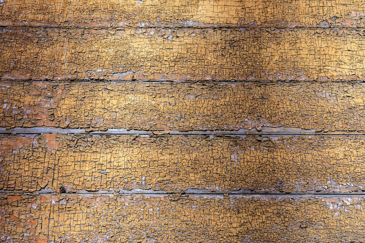 Old wooden board weathered grunge surface with cracked and peeling paint closeup as background. No People Backgraund Wallpaper Pattern Texture Architecture Close-up Details Backgrounds Textured  Full Frame Wall - Building Feature Old Weathered Damaged Wood - Material Day Rough Dirt Built Structure Wall Dirty Plank Cracked Concrete Deterioration Wood Grain Wooden Grunge Design Detail Copy Space Retro Vintage Surface Color Backdrop Aged Rustic Painted Antique Construction Material Grain Lumber